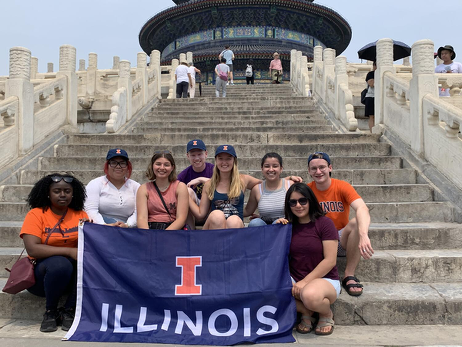 Wanxiang recipients holding an University of Illinois Flag on the steps of China's Temple of Heaven