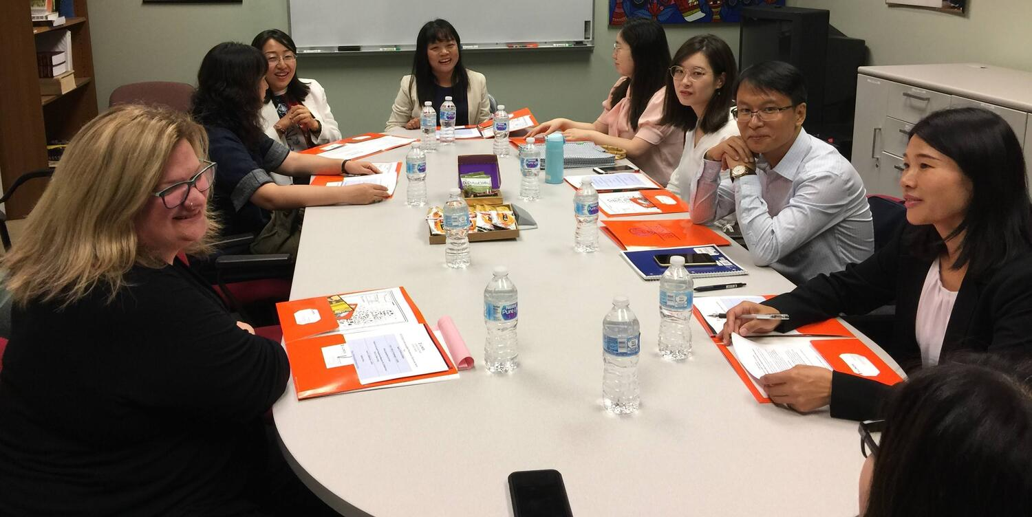 Visiting Asian Scholars and CEAPS Staff sitting together at a table